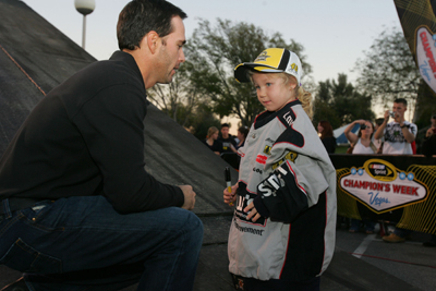 Four-time NASCAR Sprint Cup Champion Jimmie Johnson, driver of the No. 48 Lowe's Chevrolet, meets with the daughter of a member of the military at Camp Pendelton on Monday in Oceanside, Calif. (Photo Credit: Todd Warshaw/Getty Images for NASCAR)
