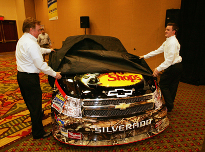 Richard Childress and grandson Austin Dillon unveil the Bass Pro Shops No. 3 Richard Childress Racing NASCAR Camping World Truck that Dillon will drive in 2010. The event took place Tuesday in Concord, N.C. during the NASCAR Sprint Media Tour Hosted by Charlotte Motor Speedway. (Credit: Harold Hinson Photography)