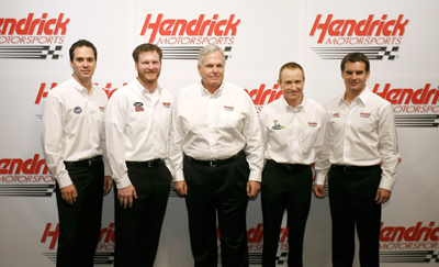 (Left to right) Jimmie Johnson, Dale Earnhardt Jr., RIck Hendrick, Mark Martin and Jeff Gordon pose for a team picture at Hendrick Motorsports Wednesday on the NASCAR Sprint Cup Media Tour Hosted by Charlotte Motor Speedway in Concord, N.C. (Credit: Jason Smith/Getty Images)