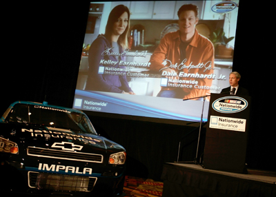 Nationwide Brand and Advertising Officer John Aman introduces a new television ad with Kelley Earnhardt and Dale Earnhardt Jr. during the Nationwide stop Wednesday on the NASCAR Sprint Cup Media Tour Hosted by Charlotte Motor Speedway in Concord, N.C. (Credit: Jason Smith/Getty Images)