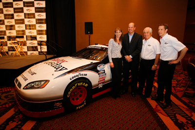 (Left to right) Sandi Stablein, Director of Marketing and Communications for Ruby Tuesday, Mark Young, Senior Vice President and Chief Marketing Officer for Ruby Tuesday, Roger Penske, NASCAR team owner, and Brad Keselowski, driver of the No. 22 Ruby Tuesday Dodge, pose during the NASCAR Sprint Media Tour hosted by Charlotte Motor Speedway and held at the Embassy Suites Monday in Concord, N.C. (Credit: Jason Smith/Getty Images)