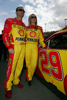 Kevin Harvick, driver of the No. 29 Shell Pennzoil Chevrolet, and wife DeLana look on from pit road before the start of Sunday's NASCAR Sprint Cup Series Auto Club 500 at Auto Club Speedway. (Credit: Todd Warshaw/Getty Images)