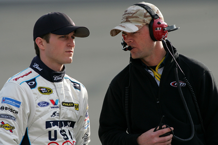 During Friday's qualifying Kasey Kahne, driver of the No. 9 Budweiser Ford, listens to crew chief Kenny Francis at Auto Club Speedway. Kahne will start Sunday's Auto Club 500 in fourth position. (Credit: Todd Warshaw/Getty Images)