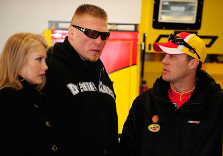 NASCAR Sprint Cup Series driver Kevin Harvick, who was second-fastest behind fellow Richard Childress Racing driver Jeff Burton in final practice, talks with MMA fighter Brock Lesnar in the garage during Daytona 500 final practice. (Credit: Jason Smith/Getty Images for NASCAR)