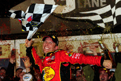 Jamie McMurray celebrates winning the Daytona 500 in his first race with Earnhardt Ganassi Racing. McMurray led two laps, the lowest total for a Daytona 500 winner. (Credit: Rusty Jarrett/Getty Images for NASCAR)