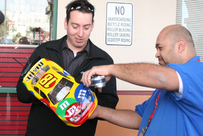 NASCAR Sprint Cup Series driver Kyle Busch talks with fellow RC racer Edwin Flores Tuesday in Las Vegas at HobbyTown USA -- a store where used to work. Busch was in his hometown to promote the Feb. 26-28 NASCAR Weekend at Las Vegas Motor Speedway.(Credit: John Bisci / Las Vegas Motor Speedway)