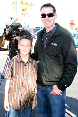 NASCAR Sprint Cup Series driver Kyle Busch says hi to Bandolero driver Austin Blair Tuesday in Las Vegas at HobbyTown USA -- a store where used to work. Busch was in his hometown to promote the Feb. 26-28 NASCAR Weekend at Las Vegas Motor Speedway. (Credit: John Bisci / Las Vegas Motor Speedway)