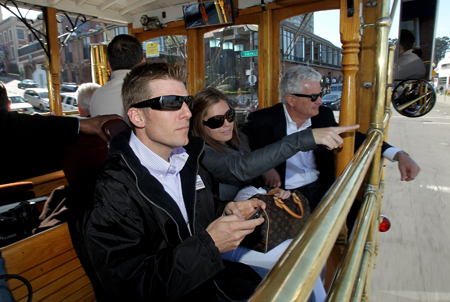 Daytona 500 champion Jamie McMurray, his wife Christy McMurray, and Infineon Raceway President and General Manager Steve Page take in the sights from inside a cable car during McMurray's victory tour of San Francisco on February 17, 2010 in San Francisco, California. (Photo by Ezra Shaw/Getty Images)