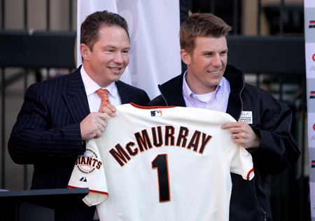 Daytona 500 champion Jamie McMurray is given a San Francisco Giants jersey by Russ Stanley, Managing Vice President, Ticket Services and Client Relations of the San Francisco Giants, during a press conference at Willie Mays Plaza in front of AT&T Park on February 17, 2010 in San Francisco, California. (Photo by Ezra Shaw/Getty Images)