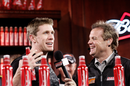 Carl Edwards talks with SPEED's Kenny Wallace Thursday after drawing the poll for the Budweiser Shootout (Credit: Jason Smith/Getty Images for NASCAR)