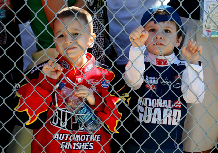 Young race fans look on during Saturday's qualifying for the Daytona 500. Jeff Gordon, driver of the No. 24 DuPont Chevrolet, later signed autographs for them. (Credit: Nick Laham/Getty Images)