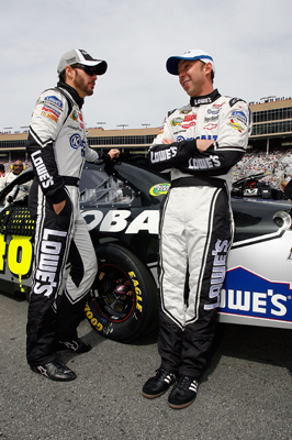 Jimmie Johnson talks with crew chief Chad Knaus before the start of Sunday's NASCAR Sprint Cup Series Kobalt Tools 500. (Credit: Jason Smith/Getty Images for NASCAR)