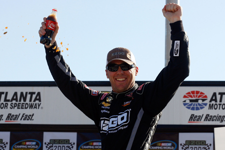 Kevin Harvick celebrates in Victory Lane after winning Sundays NASCAR Camping World Truck Series E-Z-GO 200 at Atlanta Motor Speedway. (Credit: Jason Smith/Getty Images for NASCAR)