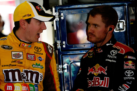 Fellow Toyota drivers Kyle Busch and Brian Vickers talk in the garage during Friday's practice for the NASCAR Sprint Cup Series Kobalt Tools 500 at Atlanta Motor Speedway.(Credit: Tom Whitmore/Getty Images for NASCAR)