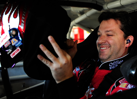 Tony Stewart straps in with a smile during practice for Sunday's NASCAR Sprint Cup Series Kobalt Tools 500 at Atlanta Motor Speedway. (Credit: Rusty Jarrett/Getty Images for NASCAR)