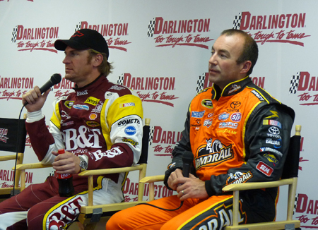 (Left to right) NASCAR Sprint Cup Series drivers Clint Bowyer and Marcos Ambrose answer questions in the James H. Hunter Media Center Tuesday during a Goodyear Tire test at Darlington Raceway in Darlington, S.C. (Credit: MotorRacingNetwork.com)