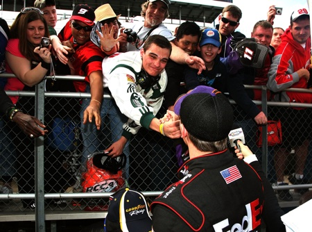 Denny Hamlin celebrates his Goody's Fast Pain Relief 500 win with his home-state fans at Martinsville Speedway. (Credit: Jerry Markland/Getty Images for NASCAR)