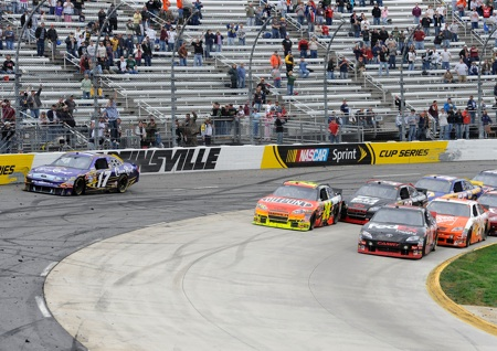After starting the green-white-checkered finish in fourth position, Denny Hamlin pushed his way to the front of the field and took the lead when Matt Kenseth cut across the field but couldnt stay in the groove. (Credit: John Harrelson/Getty Images for NASCAR)