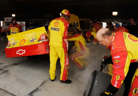 Crew members of Kevin Harvick's No. 29 Shell Pennzoil Chevrolet work on the right rear of the car after Harvick was forced to the garage during the Goody's Fast Pain Relief 500 at Martinsville Speedway. (Credit: Rusty Jarrett/Getty Images for NASCAR)