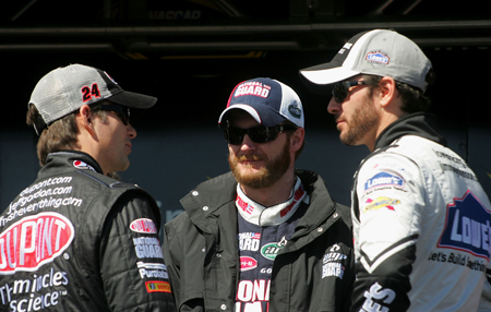 Hendrick Motorsports teammates Jeff Gordon, Dale Earnhardt Jr. and Jimmie Johnson talk during driver introductions on Sunday at Las Vegas Motor Speedway. (Credit: Jerry Markland/Getty Images for NASCAR)