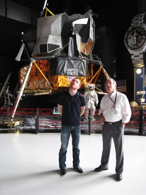Brian Vickers listens to Al Whitaker of the U.S. Space and Rocket Center in Huntsville, Ala. Behind Vickers is a replica of the Lunar Lander.