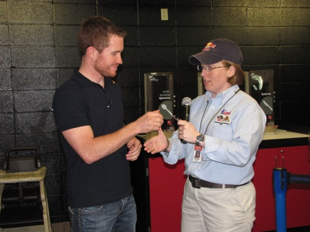 Looks like Red Bull really does give you wings. Here Brian Vickers receives his honorary astronaut wings from Aviation Challenge manager Ruth Marie Oliver (call sign: Red Bull) at the U.S. Space and Rocket Center in Huntsville, Ala.
