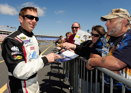 Greg Biffle chats with and sign autographs for fans who came out Tuesday for the NASCAR Sprint Cup Series test at Charlotte Motor Speedway.(Credit: Rusty Jarrett/Getty Images for NASCAR)