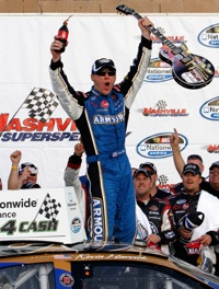 Kevin Harvick, driver of the No. 33 Armour Chevrolet celebrates in Victory Lane after winning Saturday's NASCAR Nationwide Series Nashville 300 at Nashville Superspeedway. (Credit: John Sommers II/Getty Images for NASCAR)