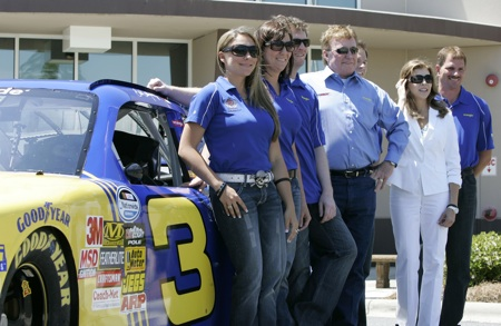(Left to right) Taylor Earnhardt, Kelley Earnhardt, Dale Earnhardt Jr., Richard Childress, Craig Errington with Wrangler, Teresa Earnhardt and Kerry Earnhardt pose for a picture with the No. 3 NASCAR Nationwide Series car at JR Motorsports in Mooresville, N.C. on Thursday.