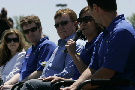 (Second from right) Kelley Earnhardt talks during a press conference Thursday at JR Motorsports in Mooresville, N.C. as (left to right) Teresa Earnhardt, Dale Earnhardt Jr., Richard Childress and Wrangler VP of Marketing Craig Errington look on.