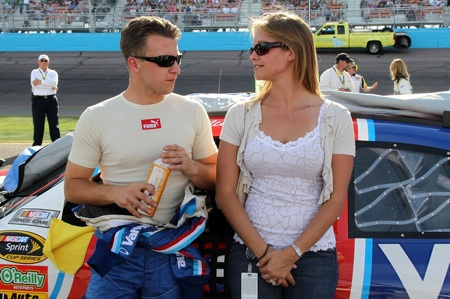 First-time polesitter AJ Allmendinger chats with wife Lynne prior to the start of the Subway Fresh Fit 600 at Phoenix International Raceway.(Credit: Christian Peterson/Getty Images)