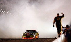 Ryan Newman does a burnout to celebrate his Subway Fresh Fit 600 victory at Phoenix International Raceway.( Credit: Tom Pennington/Getty Images for NASCAR)