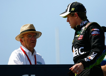 Carl Edwards updates team owner Jack Roush after the first practice for the Aaron's 499 at Talladega Superspeedway. (Credit: Geoff Burke/Getty Images for NASCAR)