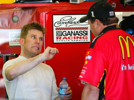 (Credit: Geoff Burke/Getty Images for NASCAR) Jamie McMurray tries to explain how the car handled in the first practice to crew chief Bono Manion. After adjustments, McMurray led the final practice and earned the Coors Light Pole Award.