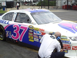 David Gilliland's No. 37 Taco Bell Ford Fusion gets checked out by a Goodyear rep during practice at Charlotte Motor Speedway on Saturday, May 29, 2010 (photo credit: The Fast and the Fabulous)