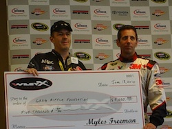 Greg Biffle accepts a $5,000 check for his foundation from WileyX