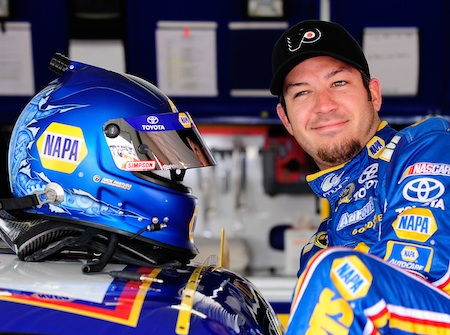 Martin Truex Jr. sports a Philadephia Flyers cap as a nod to his local hockey team in the Stanley Cup finals before climbing into his No. 56 NAPA Toyota for Saturday's first practice at Pocono Raceway. (Credit: Rusty Jarrett/Getty Images for NASCAR)