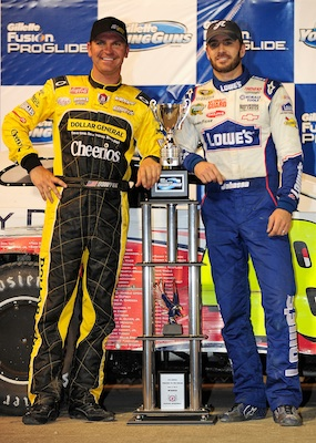 Clint Bowyer, Jimmie Johnson's car owner poses with Jimmie and the trophy after winning the Gillette Fusion ProGlide Prelude to the Dream at Eldora Speedway on June 9, 2010 in Rossburg, Ohio. (Photo by Rusty Jarrett/Getty Images for True Speed Communication)