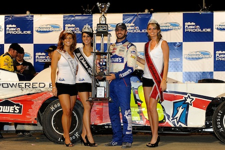 Jimmie Johnson, driver of the #48 Lowe's late model Chevrolet, celebrates in victory lane after winning the Gillette Fusion ProGlide Prelude to the Dream at Eldora Speedway on June 9, 2010 in Rossburg, Ohio. (Photo by John Harrelson/Getty Images for True Speed Communication)