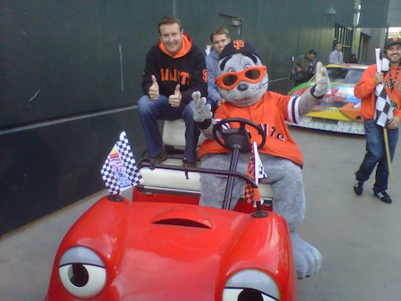 Former NASCAR Sprint Cup Series champion Kurt Busch and San Francisco Giants mascot Lou Seal pose for a quick picture in the 'pace car' before their victory lap in San Francisco on Tuesday (photo credit: NASCAR Public Relations)