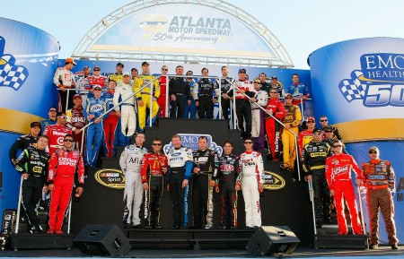 The starting field of drivers poses during pre-race ceremonies before the start of Sunday's NASCAR Sprint Cup Series Emory Healthcare 500 at Atlanta Motor Speedway. (Credit: Geoff Burke/Getty Images for NASCAR)