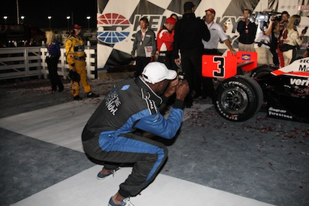 Terrell Owens takes photos in Victory Lane