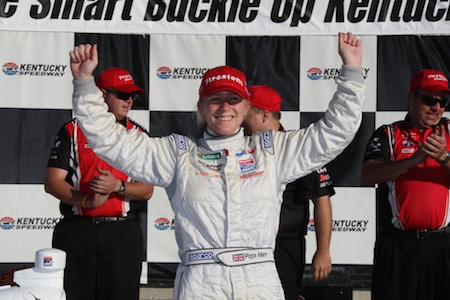 Pippa Mann celebrates her victory in the Drive Smart, Buckle Up Kentucky 100 Firestone Indy Lights race at Kentucky Speedway on Saturday, September 4, 2010