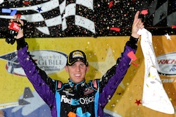 Denny Hamlin celebrates winning the Air Guard 400 at Richmond International Raceway, his second victory at his hometown track. (Credit: John Harrelson/Getty Images for NASCAR)