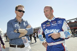 Marcos Ambrose chats with The Amazing Race host Phil Keoghan during practice for the NASCAR Sprint Cup Series Pepsi Max 400 on October 9, 2010 in Fontana, California. (Credit: Todd Warshaw/Getty Images for NASCAR)