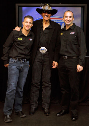 (Center) NASCAR Hall of Famer Richard Petty stands between his two NASCAR Sprint Cup Series drivers AJ Allmendinger (left) and the newest addition to Richard Petty Motorsports Marcos Ambrose during the Sprint Media Tour hosted byCharlotte Motor Speedway on Wednesday in Charlotte, N.C. (Credit: Jason Smith/Getty Images for NASCAR)
