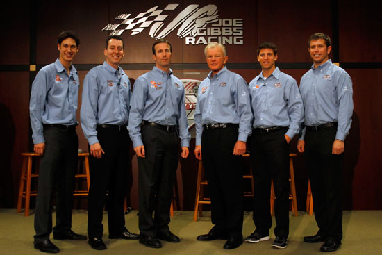 Team owner Joe Gibbs (third from right) poses with J.D. Gibbs (third from left), Joe Gibbs Racing President, Joey Logano (left), driver of the No. 20 Home Depot Toyota, Kyle Busch (second from left), driver of the No. 18 M&M's Toyota, Denny Hamlin (second from right), driver of the No. FedEx Toyota, and NASCAR Nationwide Series driver Brian Scott (right), during the NASCAR Sprint Media Tour hosted by Charlotte Motor Speedway, held at Joe Gibbs Racing, on Thursday in Huntersville, N.C. (Credit: Jason Smith/Getty Images for NASCAR)
