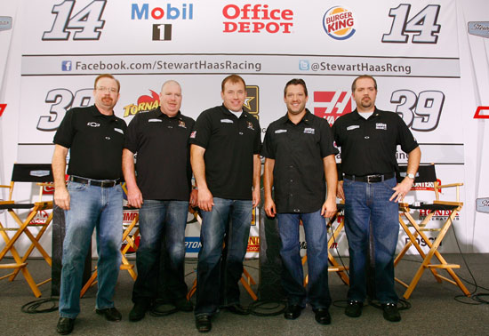 (Left to right) Bobby Hutchens, director of competition for Stewart-Haas Racing; Tony Gibson, crew chief of the No. 39 NASCAR Sprint Cup Series car; Ryan Newman, NASCAR Sprint Cup Series driver; Tony Stewart, NASCAR Sprint Cup Series owner and driver; and Darian Grubb, crew chief of the No. 14 NASCAR Sprint Cup Series car, pose for a picture during the 2011 Sprint Cup Media Tour hosted by Charlotte Motor Speedway on Monday at Stewart-Haas Racing in Kannapolis, N.C. (Credit: Jason Smith/Getty Images for NASCAR)