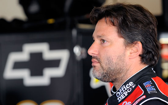 NASCAR Sprint Cup Series driver Tony Stewart looks on as his crew makes adjustments to the No. 14 Office Depot Chevrolet Saturday at Daytona International Speedway in Daytona Beach, Fla. during Preseason Thunder testing.(Credit: Jared C. Tilton/Getty Images for NASCAR)