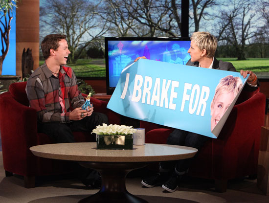 Trevor Bayne gets a gift from talk-show host Ellen Degeneres